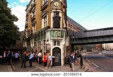 LONDON, UNITED KINGDOM - AUGUST 15, 2017: Traditional pub - The Black Friar - and smal front of house, at Blackfriars bridge, on August 15, 2017 in London, England