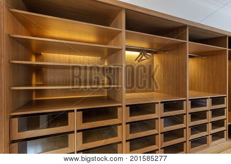 Large wardrobe closet, with empty shelves. In house
