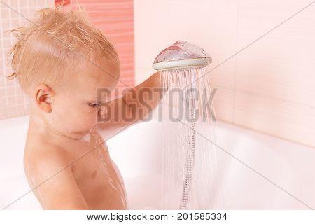 Cute Toddler In A Foam Taking A Douche, Shower