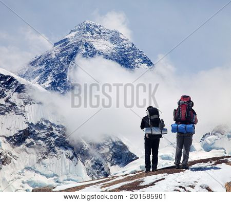 Panoramic view of Mount Everest from Kala Patthar with two tourists on the way to Everest base camp Sagarmatha national park Khumbu valley - Nepal