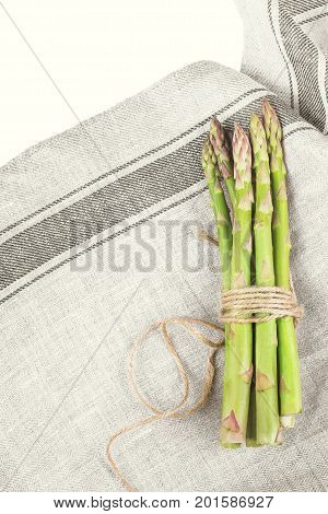 Asparagus. Raw asparagus with kitchen towel top view with copy space