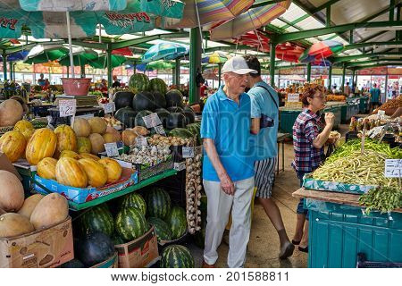 CONSTANTA ROMANIA - AUGUST 20 2017: Grivitei Market on Sunday morning with colorful fruit and vegetables sold by local producers.