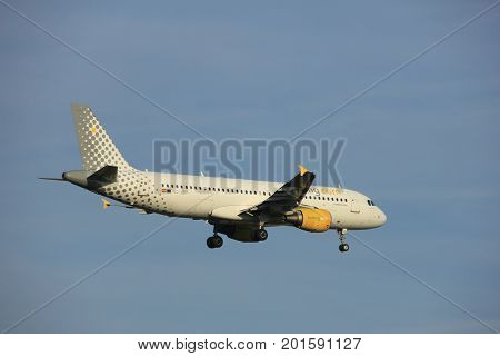 Amsterdam the Netherlands - July 7th 2017:EC-JZI Vueling Airbus A320 approaching Schiphol Amsterdam Airport Polderbaan runway
