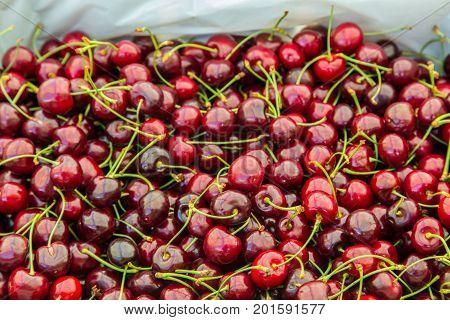 Pile of Bing cherries in a basket