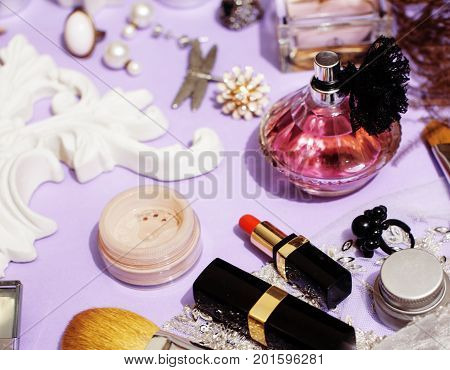 Jewelry table with lot of girl stuff on it, little mess in cosmetic brushes, women interior concept, perfume elegance things, little princess makeup close up