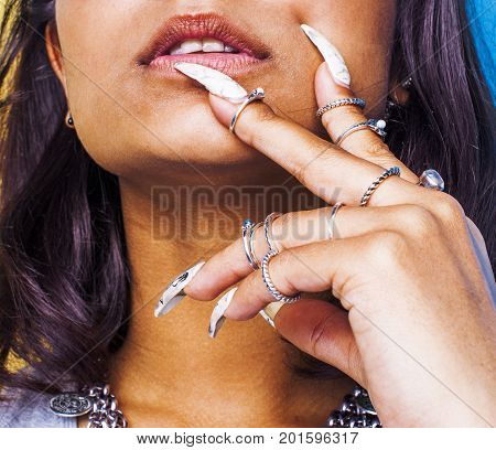 lifestyle people concept. young pretty smiling indian girl with long nails wearing lot of jewelry rings, asian summer happy cool close up copyspace