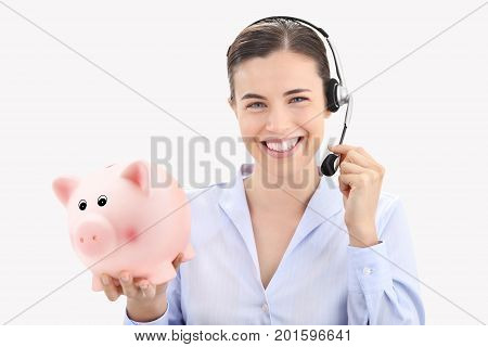 smiling woman with headset and piggy bank isolated on white background