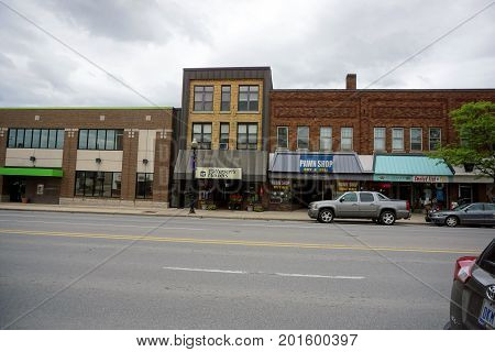 CADILLAC, MICHIGAN / UNITED STATES - MAY 31, 2017: One may buy a bouquet at Patterson's Flowers, pawn one's belongings at Better than a Pawn Shop, or buy merchandise at the Ultimate Gift Shop, in Downtown Cadillac.