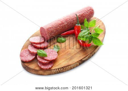 Wooden board with delicious sliced sausage and chili pepper on white background