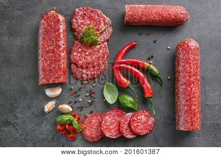 Composition with delicious sliced sausage and spice on table