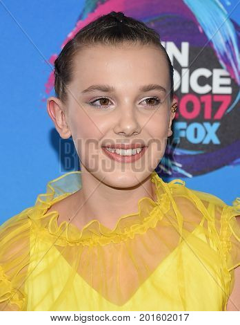 LOS ANGELES - AUG 13:  Millie Bobby Brown arrives for the Teen Choice Awards 2017 on August 13, 2017 in Los Angeles, CA