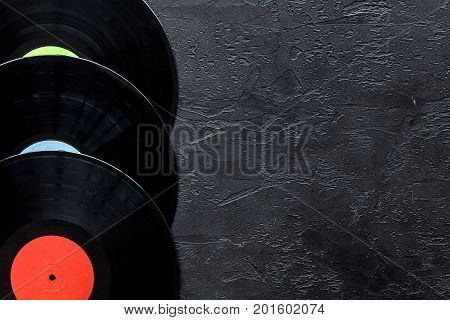 Desk of musician or dj with vynil records for songwriter work set on dark background top view mockup