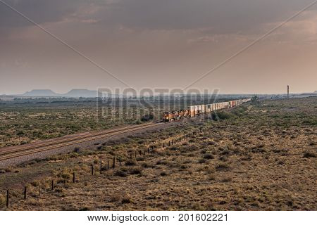 Diagonal View of Train Rolling Across Desert in late afternoon