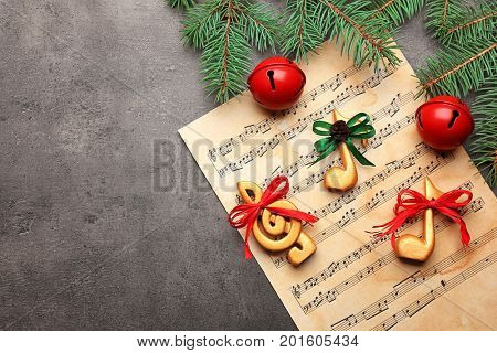 Beautiful composition with decorations on music sheet. Christmas songs concept