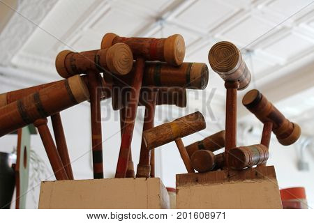 Old Wooden crochet mallets, from days gone by, colored bands that have faded over the years