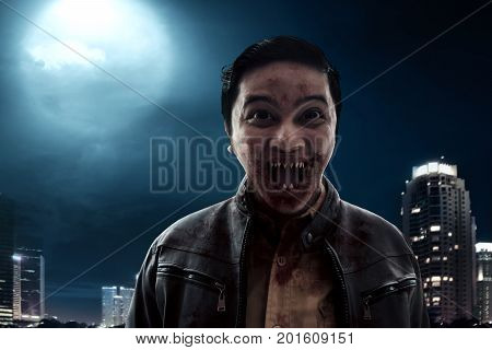 Vampire on city building background at night