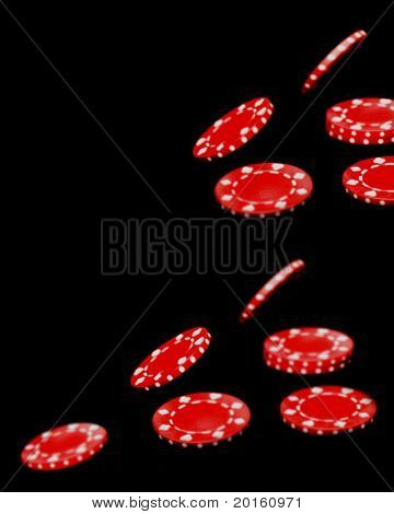 Let the chips fall where they may  Red poker chips on black