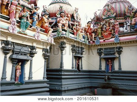 SINGAPORE / CIRCA 1990: Sacred sculptures adorn the roof and walls of the Sri Mariamman Temple, Singapore's oldest Hindu temple.