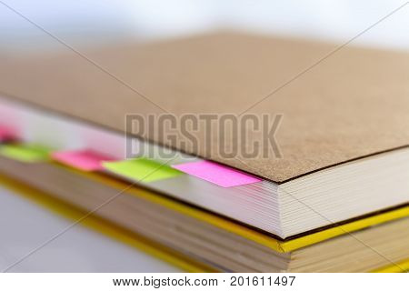 book and sticky note (post it note)