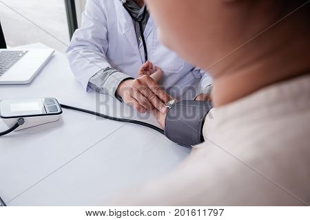 Patient Listening Intently To A Male Doctor Explaining Patient Symptoms Or Asking A Question As They