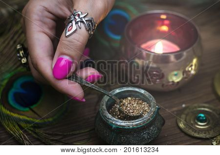 Witch prepares a magic potion. Fortune teller table. Divination. Witchcraft.