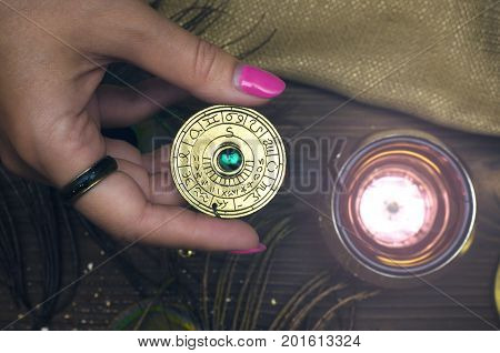 Amulet with zodiac signs in fortune teller hands. Divination. Witchcraft.
