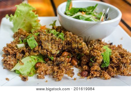 The Best Thai Food. Crispy catfish salad with green mango. Minced Catfish Spicy Salad with Herbs. Exploded catfish salad