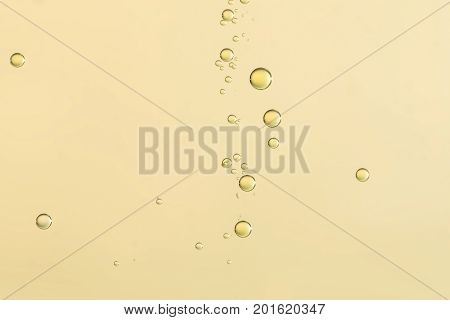 Yellow fizz bubbles isolated over a blurred background