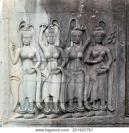 Dancing Apsaras bas relief in Angkor Wat Siem Reap Cambodia Asia