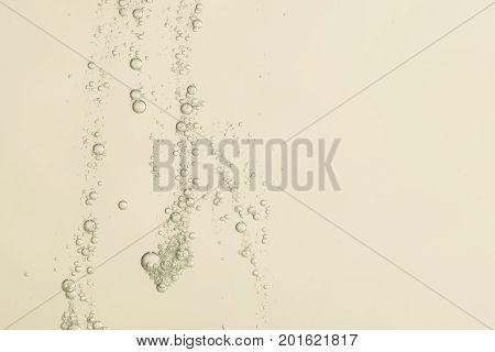 Beautiful golden fizz bubbles in a champagne glass