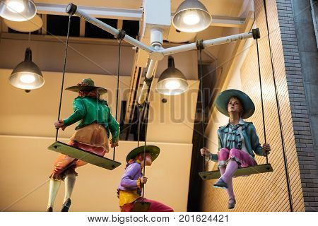 Hanging beautiful girl model dolls decorated at retail shopping mall Fashion concept