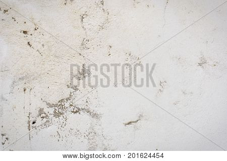 Background Of A White Stucco Coated And Painted Exterior, Rough Cast Of Cement And Concrete Wall Tex