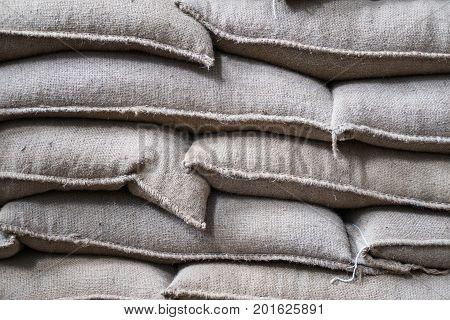 Hemp Sacks Containing Coffee Bean In Warehouse. Stacked Sacks In Storehouse.