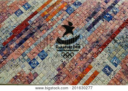 Ceramic Wall With Singapore Olympic Games Logo