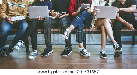 young people being used computer and tablet. education and technology concept.