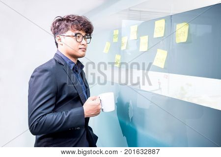 Asian businessman with coffee in the meeting room