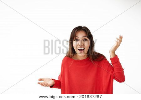 Human facial expressions. Picture of emotional ecstatic beautiful student girl in red sweater exclaiming and gesturing in excitement. People success winning victory and celebrating concept