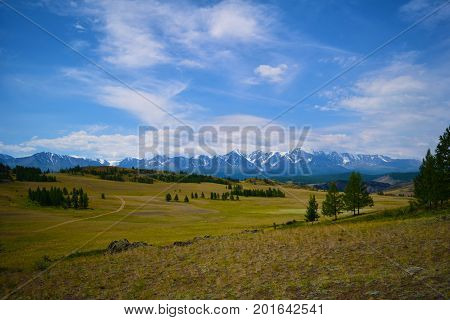 Pictorial landscape of snow peaks of North-Chiyski ridge and Kurai steppe in Altai mountains. Republic of Altay Russia.