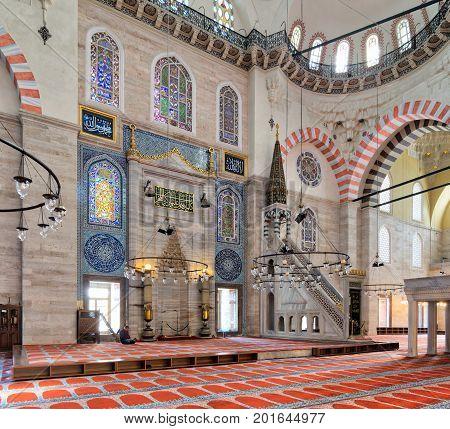 Istanbul, Turkey - April 19, 2017: Marble floral golden ornate minbar (Platform) and niche Suleymaniye Mosque Istanbul Turkey