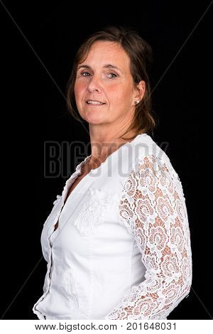 portrait of candid attractive mid-aged caucasian female adult - studio shot in front of dark background