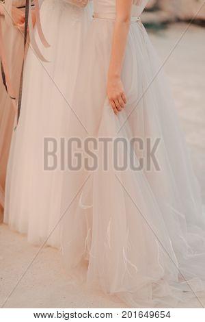Girl in white dress under the sunlight
