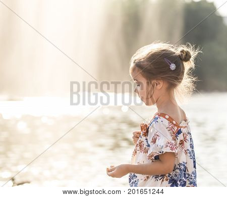 Little Girl Near The Water