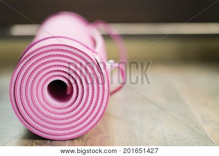 pink yoga mat on the yoga class exercise