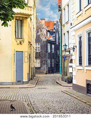 Medieval street in old Riga where tourists can feel unforgettable atmosphere of the Middle Ages, Latvia, Europe