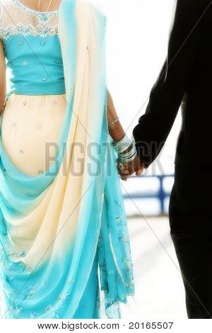 indian bride and groom walking away together