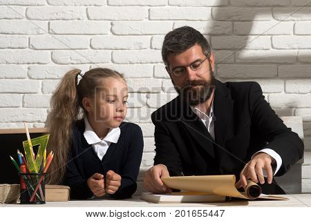 Education And Family Relationship Concept. Girl And Father In Classroom