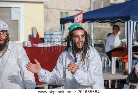HEBRON ISRAEL - APRIL 12 2009: Undefined ultra orthodox jewish guys dance on Hebron street