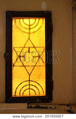 HEBRON, ISRAEL - APRIL 12, 2009: Stained glass window in of synagogue in Hebron
