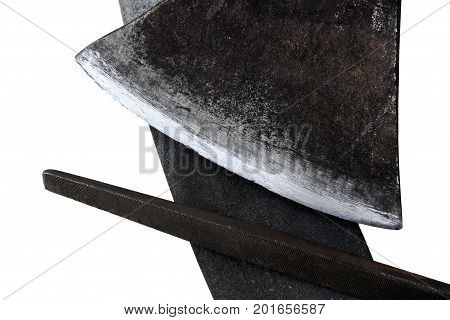 Old sharpening stone and rasp and a blade of an ax as the concept of tool sharpening isolated on a white background