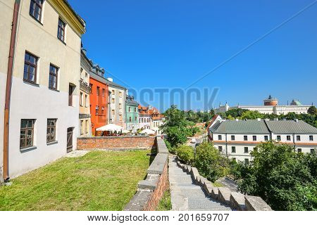 Lublin, Poland - August 10, 2017: Beautiful street and old bright buildings in the old town of center Lublin, Poland. Cityscape and bright blue sky in Lublin, Poland